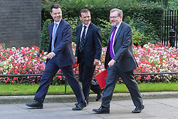 Downing Street, London, September 13th 2016. Northern Ireland Secretary James Brokenshire (left), Welsh Secretary Alun Cairns and Scotland Secretary David Mundell (right) arrive for the weekly cabinet meeting at Downing Street.