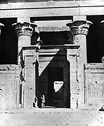 Temple of Edfu, dedicated to the  Ancient Egyptian falcon-headed god Horus. Photographed in 1860s during work of Auguste Mariette-Bey (1821-1881) French archaeologist and founder of the Egyptian Museum, Cairo in 1863.