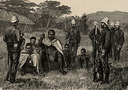 Cetawayo or Cetewayo (d1884) king of Zululand, South Africa 1873-1883.  During the Anglo-Zulu war of 1879 Cetawayo was defeated at Ulundi and taken prisoner. Here he is shown under guard in the British army encampment on the Black Umvolosi.  Illustration by Frank Dadd (1851-1929) English artist and illustrator.  From 'The Illustrated London News' (London, 18 August 1879). Engraving.
