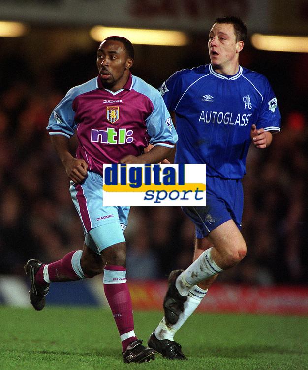 Darius Vassell (Aston Villa) and John Terry (Chelsea). Chelsea v Aston Villa. FA Premiership, 1/1/01. Credit: Colorsport / Andrew Cowie.