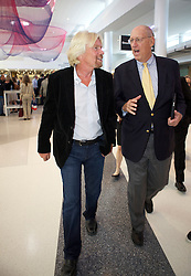 Virgin Group Founder Sir Richard Branson,(L), is given a tour by Arthur Gensler, architect of the new Terminal 2 at San Francisco International Airport.  The 640,000- square-foot Terminal is expected to be the first LEED Gold-certified terminal in the U.S.