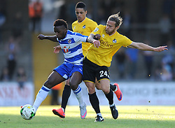 Stuart Sinclair of Bristol Rovers jostles for the ball with Tariq Fosu of Reading - Mandatory by-line: Dougie Allward/JMP - 21/07/2015 - SPORT - FOOTBALL - Bristol,England - Memorial Stadium - Bristol Rovers v Reading - Pre-Season Friendly