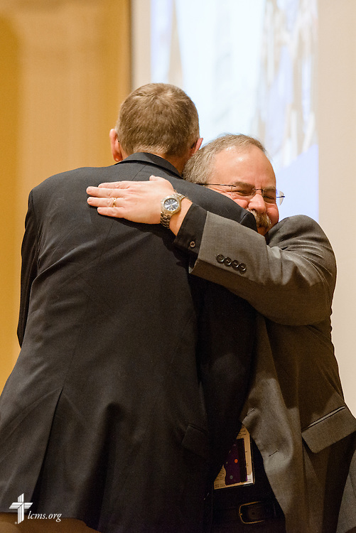 The Rev. Eric Linthicum, pastor at Redeemer Lutheran Church, Hyattsville, Md., hugs retired Chaplain Rev. Dr. Daniel Gard, president of Concordia University Chicago, River Forest, Ill., during an introduction at the Liberty National LCMS Campus Ministry Conference on Wednesday, Jan. 4, 2017, at the University of Maryland in College Park, Md. LCMS Communications/Erik M. Lunsford