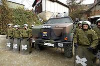 05 DEC 2005, SERBIA/KOSOVO/PRIZREN:<br /> Bundeswehrsoldaten mit Schild und Helm, und ein Dingo, gepanzertes Allschutz-Transportfahrzeug (ATF) der Bundeswehr, hergestellt von Krauss-Maffei Wegmann (KMW), waehrend einer Vorfuehrung zum Vorgehen bei angenommenen Unruhen, Deutsches Kontingent der KFOR Schutztruppe, Inenstadt von Prizren<br /> IMAGE: 20051205-01-051<br /> KEYWORDS: Unimog, Soldat