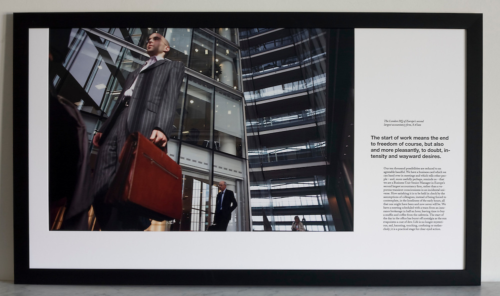 Arriving for work beneath atrium of an auditing company's London headquarters.<br />