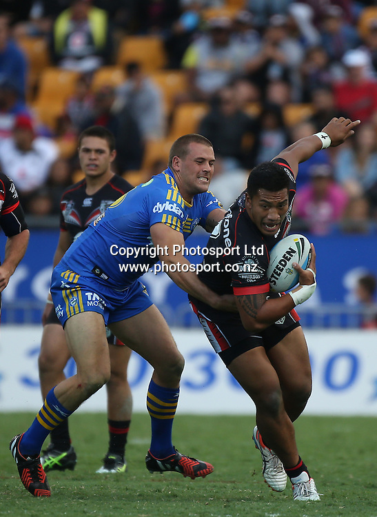 NZ Warriors player Albert Vete makes a break during  the NRL Rugby League match between the NZ Warriors and the Parramatta Eels played at Mt Smart Stadium in South Auckland on the 21st March 2015. <br /> <br /> Copyright Photo; Peter Meecham/ www.photosport.co.nz