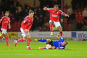 Keith Keane tackles Nathan Thompson during the EFL Sky Bet League 1 match between Swindon Town and Rochdale at the County Ground, Swindon, England on 18 October 2016. Photo by Daniel Youngs.