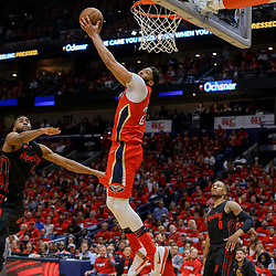 Apr 19, 2018; New Orleans, LA, USA; New Orleans Pelicans forward Anthony Davis (23) dunks over Portland Trail Blazers forward Maurice Harkless (4) and guard Damian Lillard (0) during the second quarter in game three of the first round of the 2018 NBA Playoffs at the Smoothie King Center. Mandatory Credit: Derick E. Hingle-USA TODAY Sports