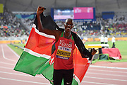 Timothy Cheruiyot (KEN) poses with Kenyan flag after winning the 1,500m in 3:29.26 during the IAAF World Athletics Championships, Sunday, Oct.. 6, 2019, in Doha, Qatar. (Jiro Mochizuki/Image of Sport)