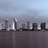 Picture of San Diego skyline at night with downtown city office buildings along San Diego Bay. San Diego is a major city along the Pacific Ocean in Southern California in the United States of America. Photo is high resolution and was taken in 2012.