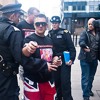 London, UK - 29 June 2013: EDL leaders Tommy Robinson and Kevin Carroll are arrested trying to march through London borough of Tower Hamlets