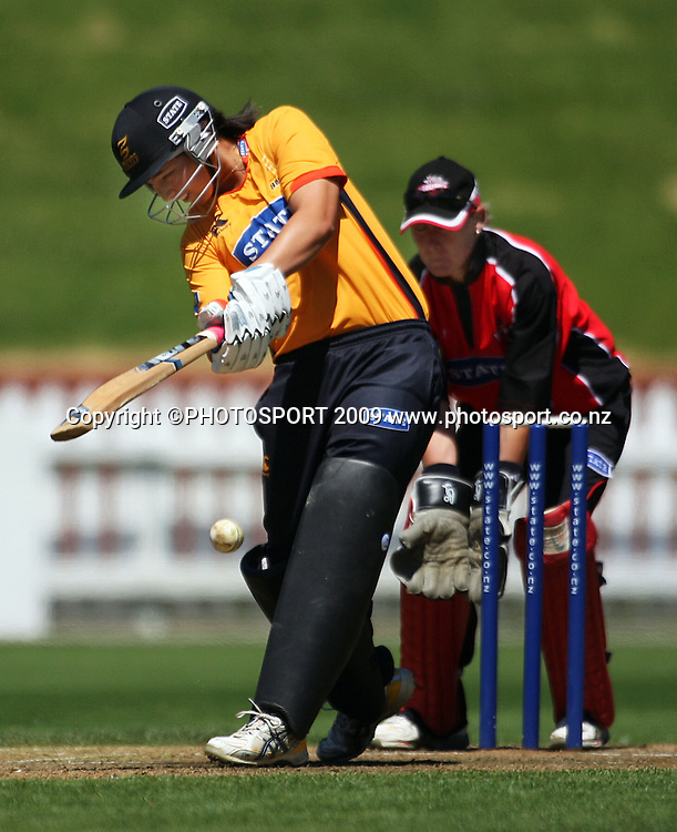 Wellington's Kerry-Anne Tomlinson bats as Canterbury keeper Rowan Milburn braces.<br /> State League final. Wellington Blaze v Canterbury Magicians at Allied Prime Basin Reserve, Wellington. Saturday, 24 January 2009. Photo: Dave Lintott/PHOTOSPORT