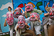 Members of the Bread and Puppet theater group wore glum-faced papier-mâché masks while grumpily moving across the stage.