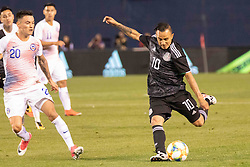 March 22, 2019 - San Diego, CA, U.S. - SAN DIEGO, CA - MARCH 22: Mexico midfielder Luis Montes (10) takes a shot at goal during the International match between the Mexico National Team and Chile on March 22, 2019 at SDCCU Stadium in San Diego, CA.(Photo by Alan Smith/Icon Sportswire) (Credit Image: © Alan Smith/Icon SMI via ZUMA Press)