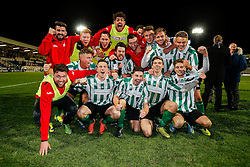 BBC Pundit Alan Shearer (R) looks on as The Blyth Spartans team celebrates on the pitch after they win 1-2 to progress to the next round of the FA Cup - Photo mandatory by-line: Rogan Thomson/JMP - 07966 386802 - 05/12/2014 - SPORT - FOOTBALL - Hartlepool, England - Victoria Park - Hartlepool United v Blyth Spartans - FA Cup Second Round Proper.