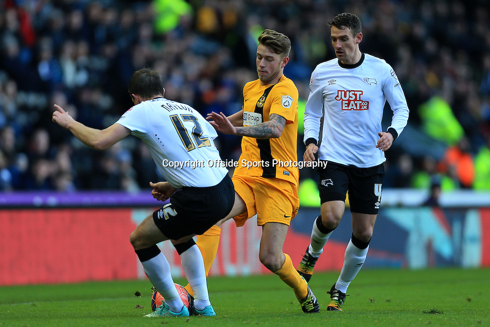 3rd January 2015 - FA Cup - 3rd Round - Derby County v Southport - Charlie Joyce of Southport battles with Lee Naylor of Derby (L) and Craig Bryson of Derby - Photo: Simon Stacpoole / Offside.