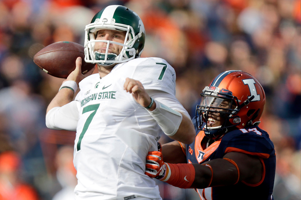 Michigan State quarterback Tyler O'Connor (7) throws under pressure from Illinois defensive lineman Gimel President (14) during the second half of an NCAA college football game at Memorial Stadium Saturday, Nov. 5, 2016, in Champaign, Ill. Illinois won the game 31-27. (AP Photo/ Stephen Haas)