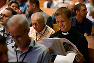 Attendees browse the program at the 2017 Institute on Liturgy, Preaching and Church Music on Tuesday, July 25, 2017, at Concordia University Chicago in River Forest, Ill. LCMS Communications/Erik M. Lunsford