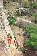 "Climber climbing a steep limestone route in Cuenca named ""Franja de Gaza"", Spain"