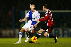 Joe Partington of Bristol Rovers is challenged by John Fleck of Sheffield United - Rogan Thomson/JMP - 14/02/2017 - FOOTBALL - Memorial Stadium - Bristol, England - Bristol Rovers v Sheffield United - Sky Bet League One.