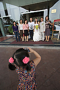 Wedding party at Saigon Halong hotel. Little girl taking a souvenir photo.