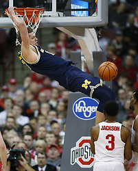 December 4, 2017 - Columbus, OH, USA - Michigan Wolverines forward Moritz Wagner (13) dunks the ball in front of Ohio State Buckeyes guard C.J. Jackson (3) during the first half on Monday, Dec. 4, 2017, at Value Center Arena in Columbus, Ohio. (Credit Image: © Fred Squillante/TNS via ZUMA Wire)