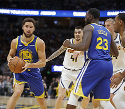 October 21, 2018 - Denver, Colorado, U.S - Warriors KLAY THOMPSON, left, looks to pass the ball during the 1st. Half at the Pepsi Center Sunday night. The Nuggets beat the Warriors 100-98. (Credit Image: © Hector Acevedo/ZUMA Wire)