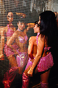 Club dancers infront of tiled mirror wall Birmingham September 2000