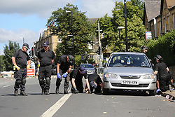 © Licensed to London News Pictures. 29/08/2016. Leeds, UK. A police team search the street where a shooting is believed to have taken place last night. This is as yet unconfirmed by the police. The incident happened in the Chappeltown area of Leeds where the West Indian Carnival is taking place this weekend. Photo credit : Ian Hinchliffe/LNP