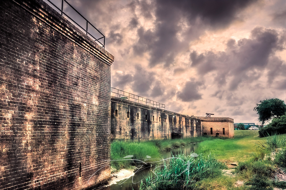 """The sun sets at Fort Gaines on the east end of Dauphin Island, Alabama, May 16, 2015. The fort was established in 1821 and played a pivotal rolr during the Civil Wat in the Battle of Mobile Bay. Constant erosion due to storms and hurricanes is threatening the fort, and it is on the Civil War Preservation Trust's """"History Under Siege"""" list as one of 10 of the nation's most endangered Civil War battlefields. It was also listed as one of the National Trust for Historic Preservation's """"America's 11 Most Endangered Historic Places"""" in 2011, and it has been nominated to be a National Historic Landmark. (Photo by Carmen K. Sisson/Cloudybright)"""