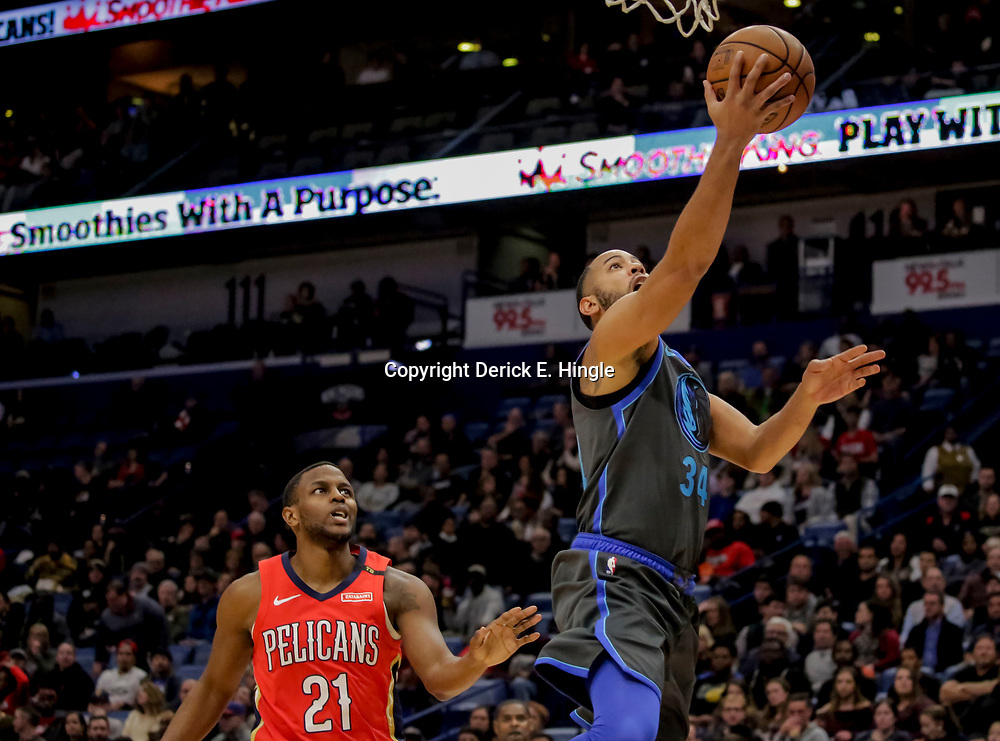 Dec 5, 2018; New Orleans, LA, USA; Dallas Mavericks guard Devin Harris (34) shoots over New Orleans Pelicans forward Darius Miller (21) during the first quarter at the Smoothie King Center. Mandatory Credit: Derick E. Hingle-USA TODAY Sports