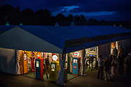 Customers browse at the vintage shops during the Goodwood Revival in Chichester, England   Friday, Sept. 9, 2016 The historic motor racing festival celebrates the mid-20th-century golden era of the racing circuit and recreates the atmosphere from the 1950s and 1960s.(Elizabeth Dalziel)
