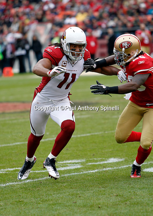 Arizona Cardinals wide receiver Larry Fitzgerald (11) goes out for a pass while getting bump coverage from San Francisco 49ers cornerback Tramaine Brock (26) during the NFL week 17 football game on Sunday, January 2, 2011 in San Francisco, California. The 49ers won the game 38-7. (©Paul Anthony Spinelli)