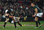 JOHANNESBURG, South Africa, 25 July 2015 : Kieran Read of the All Blacks is tackled by Heinrich Brussow of the Springboks during the Castle Lager Rugby Championship test match between SOUTH AFRICA and NEW ZEALAND at Emirates Airline Park in Johannesburg, South Africa on 25 July 2015. Bokke 20 - 27 All Blacks<br /> <br /> © Anton de Villiers / SASPA