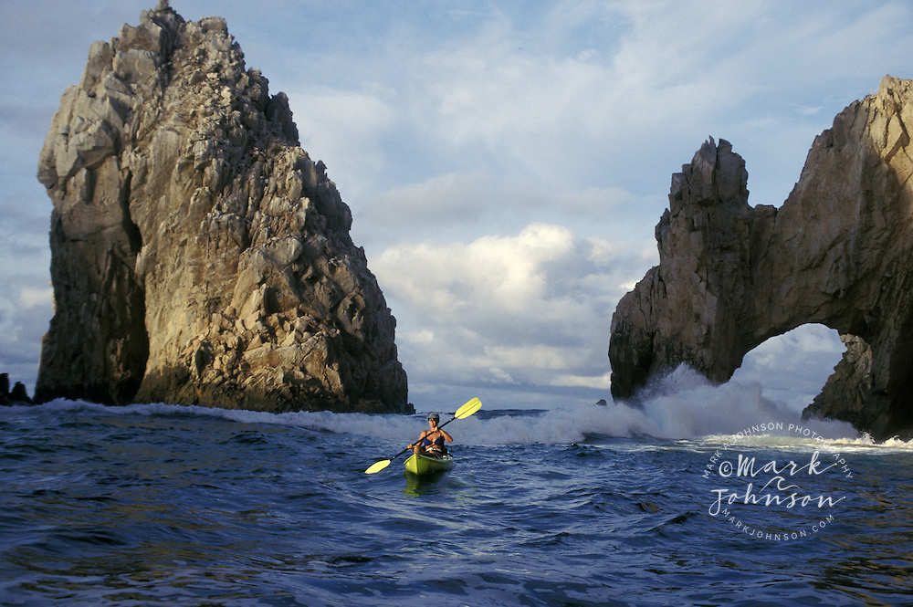 Woman kayaker paddling off The Arch, Cabo San Lucas, Baja California Sur, Mexico ****Model Release available