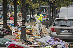 November 4, 2016 - Paris, France - Worker seen cleaning the area in neighbor where the refugees stay rough in the streets around the Stalingrad Metro station, in Paris, France, on 4 November 2016. (Credit Image: © Julien Mattia/NurPhoto via ZUMA Press)