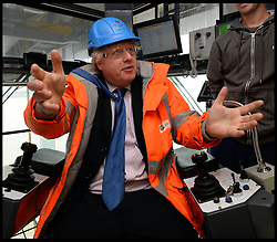 Mayor of London visit to DP World London Gateway.<br /> The Mayor of London, Boris Johnson poses in a crane during a visit to the DP World London Gateway site to see for himself the progress made on its construction and to discuss the benefits the port will have for London,<br /> Essex, United Kingdom<br /> Tuesday, 30th July 2013<br /> Picture by Andrew Parsons / i-Images