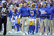 Dec 30, 2018; Los Angeles, CA, USA; Los Angeles Rams head coach Sean McVay looks on as he talks into his headset at Los Angeles Memorial Coliseum. The Rams defeated the 49ers 48-31.  (Robin Alam/Image of Sport)