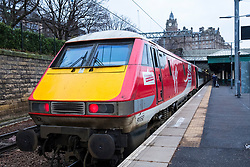 Virgin Trains locomotive from London King's Cross on East Coast Main line  at platform at Waverley Station in Edinburgh, Scotland, United Kingdom