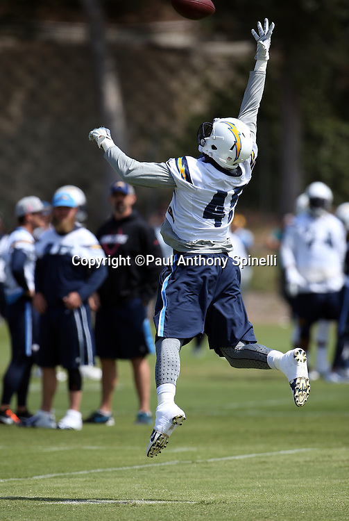San Diego Chargers tight end Asante Cleveland (45) leaps while trying to catch a pass with one hand during the Chargers 2016 NFL minicamp football practice held on Tuesday, June 15, 2016 in San Diego. (©Paul Anthony Spinelli)