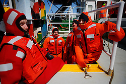 ATLANTIC OCEAN ABOARD ARCTIC SUNRISE 21MAY11 -  Greenpeace activists wear survival suits prior to swim training in the north Atlantic.....Photo by Jiri Rezac / Greenpeace