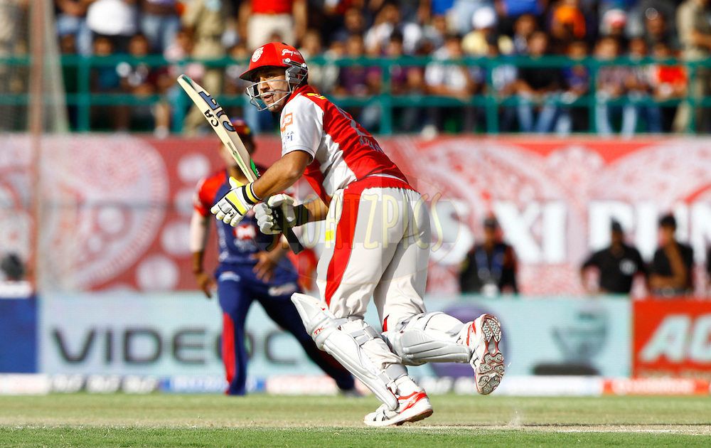 Kings XI Punjab player Azar Mahmood play a shot during match 69 of the the Indian Premier League ( IPL) 2012  between The Kings X1 Punjab and The Delhi Daredevils held at the HPCA Stadium, Dharamsala, on the 19th May 2012..Photo by Pankaj Nangia/IPL/SPORTZPICS