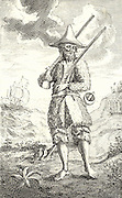 Robinson Crusoe, barefoot and dressed in goatskins, pictured on the island where he spent many years after his shipwreck.  Frontispiece of the first edition of 'The Life and Strange Surprising Adventures of Robinson Crusoe' by Daniel Defoe (London, 1719).