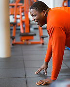 Jay Bromley, a defensive tackle for the Syracuse University football team, works out in Syracuse, New York on Friday, May 2, 2014. Bromley, who attended Flushing High School, is projected as a late-round NFL draft pick.