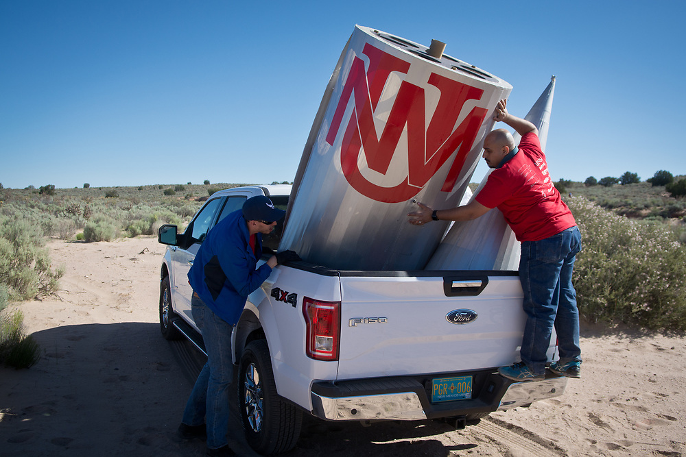 Lobo Launch's Ahmed Almalki, right, and Niccoli Scalice, left, load up a pickup with pieces from their class's 47 feet high rocket, which broke apart after traveling a couple hundred feet from a remote launch site in Rio Rancho, Saturday, May 27, 2017. The rocket was built by a mechanical engineering class at the University of New Mexico. (Marla Brose/Albuquerque Journal)