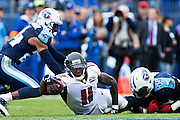 NASHVILLE, TN - OCTOBER 25:  Julio Jones #11 of the Atlanta Falcons reaches the ball out to try and get a first down after being tackled by Zach Brown #55 of the Tennessee Titans at Nissan Stadium on October 25, 2015 in Nashville, Tennessee.  The Falcons defeated the Titans 10-7.  (Photo by Wesley Hitt/Getty Images) *** Local Caption *** Julio Jones; Zach Brown