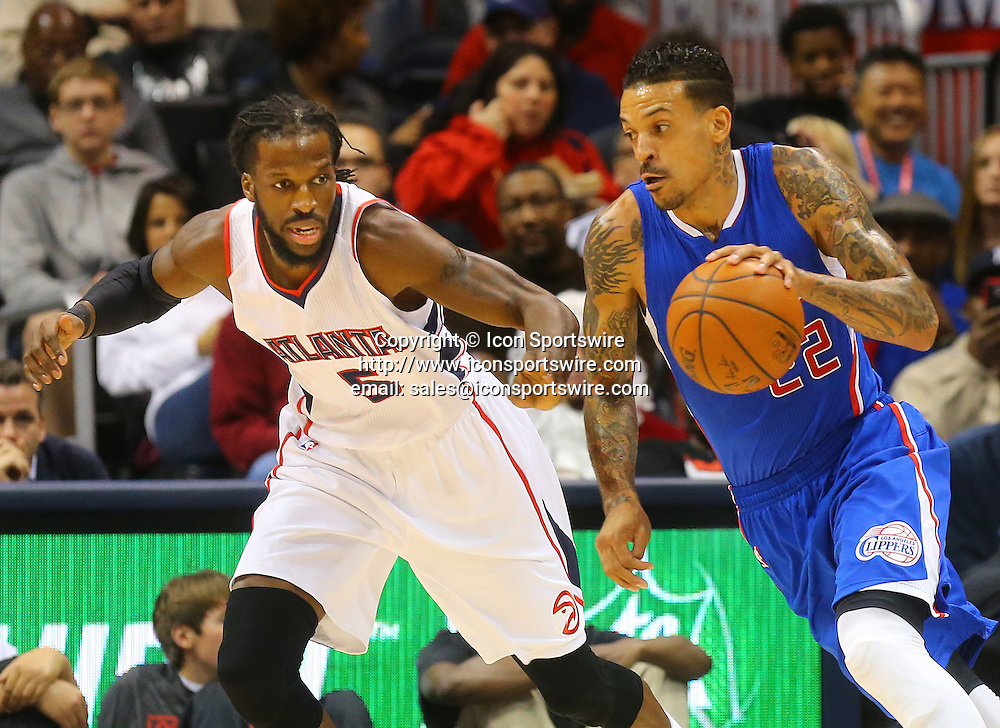 Dec. 23, 2014 - Atlanta, GA, USA - The Los Angeles Clippers' Matt Barnes, right, drives against the Atlanta Hawks' DeMarre Carroll during the first half at Philips Arena in Atlanta on Monday, Dec. 23, 2014