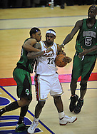"Cleveland's LeBron James get tangles with Boston's Kevin Garnett and Paul Pierce. The play ended up spilling into the floor seats causing LeBron's mom, Gloria James, to get involved in the play. LeBron yelled for her to, ""Sit down!"""