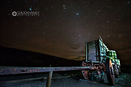 The Milky Way over the historic Borax Wagons at night in Death Valley National Park, California, USA