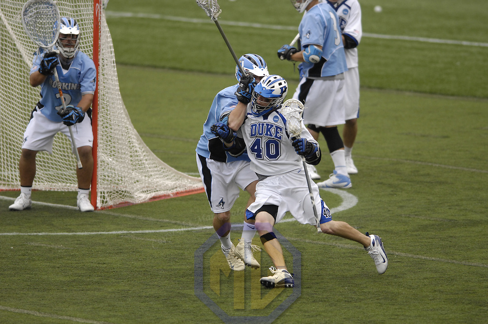 28 May 2007:  Duke University Blue Devils attacker Matt Danowski (40) tries to manuver around the defense of Johns Hopkins Univesity defender Adndrew Miller (3) to fire a shot in the NCAA Division I Lacrosse Championship game.  The Johns Hopkins Blue Jays defeated the Duke Blue Devils 12-11 to win the NCAA Division I Lacrosse championship at M&T Bank Stadium in Baltimore, Md. .